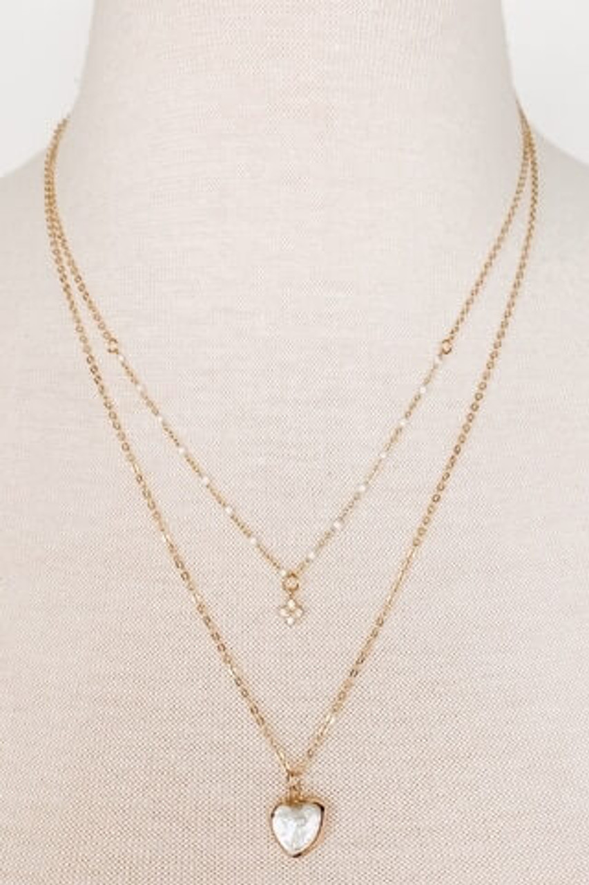 "Delicate 2-in-1 goldtone necklace with lobsterclaw close. Adjustable from 16"" to 18""; longer chain drops an additional inch. Pendant is .5"" long. Nickle and lead free."