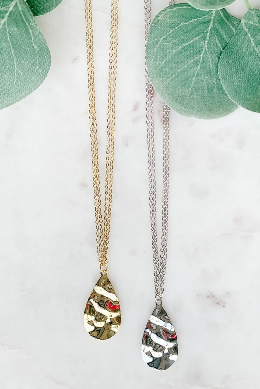 """Silver tone hammered teardrop pendant necklace. Double chain with lobsterclaw clasp is adjustable from 15.5"""" to 17.5"""". Nickel and lead free."""