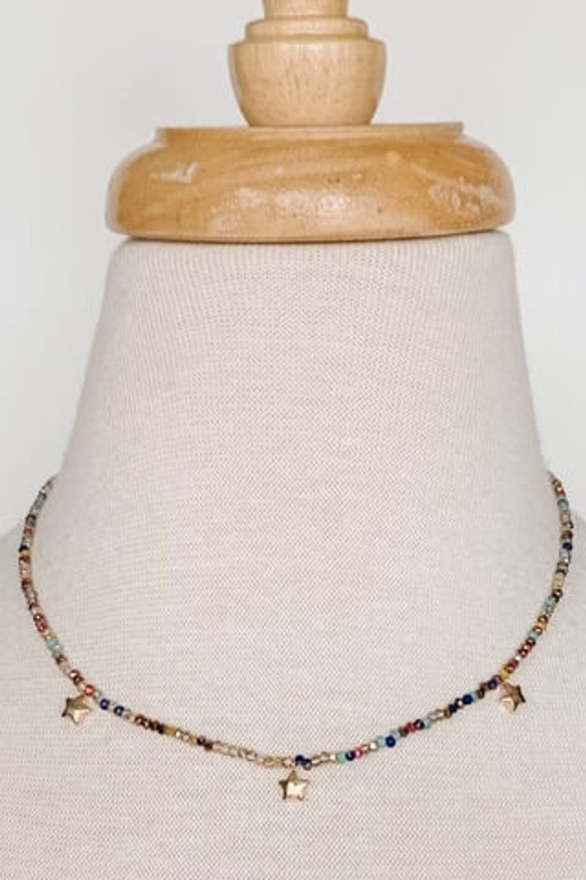 "Short multi-color seed bead and star necklace with lobsterclaw clasp. Adjustable from 13.5"" to 16"". Nickel and lead free."