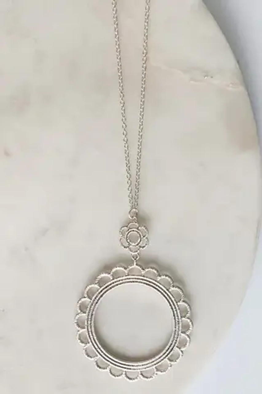 """silver Flower pendant with a thread wrapped lace look on a long necklace. Adjustable from 30"""" to 33"""".Nickel and lead free."""