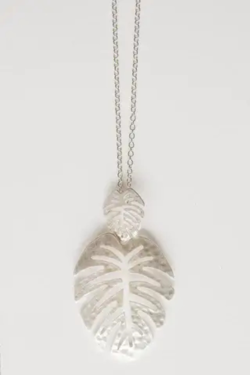 """Double palm leaf pendant. Nickel and lead free. Lobsterclaw clasp on long chain adjustable from 30"""" to 33"""". Pendant set is about 2.5""""."""