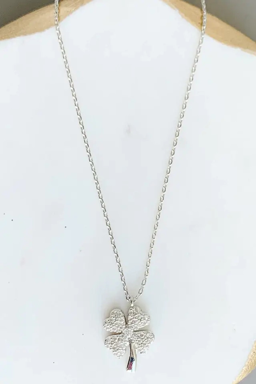 """Pretty AND lucky! White gold-dipped brass and cubic zirconia 5/8"""" charm on delicate chain adjustable from 15.5""""-17.5"""" with lobsterclaw clasp. Nickel and lead free."""