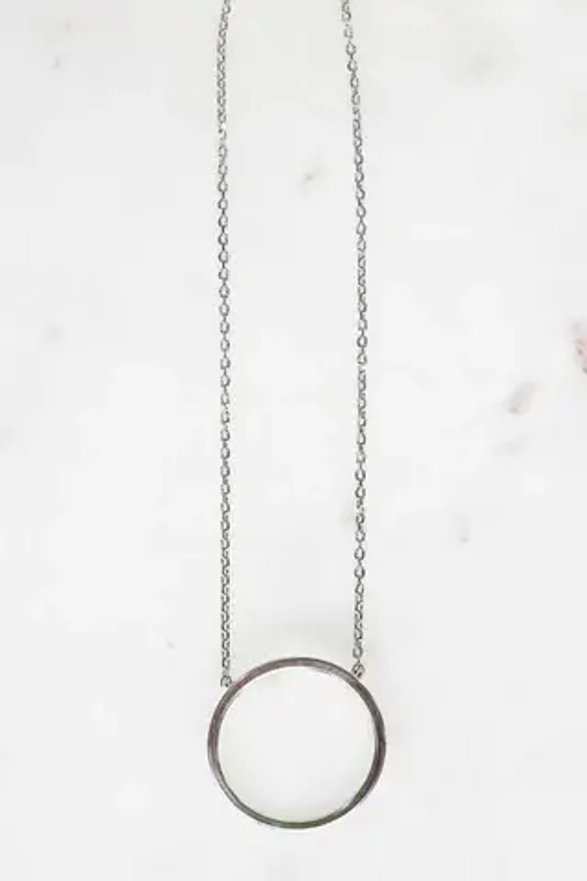 """White gold dipped 3/4"""" circle charm on dainty chain that is adjustable from 15.5""""-17.5"""". Lobsterclaw clasp. Nickel and lead free."""