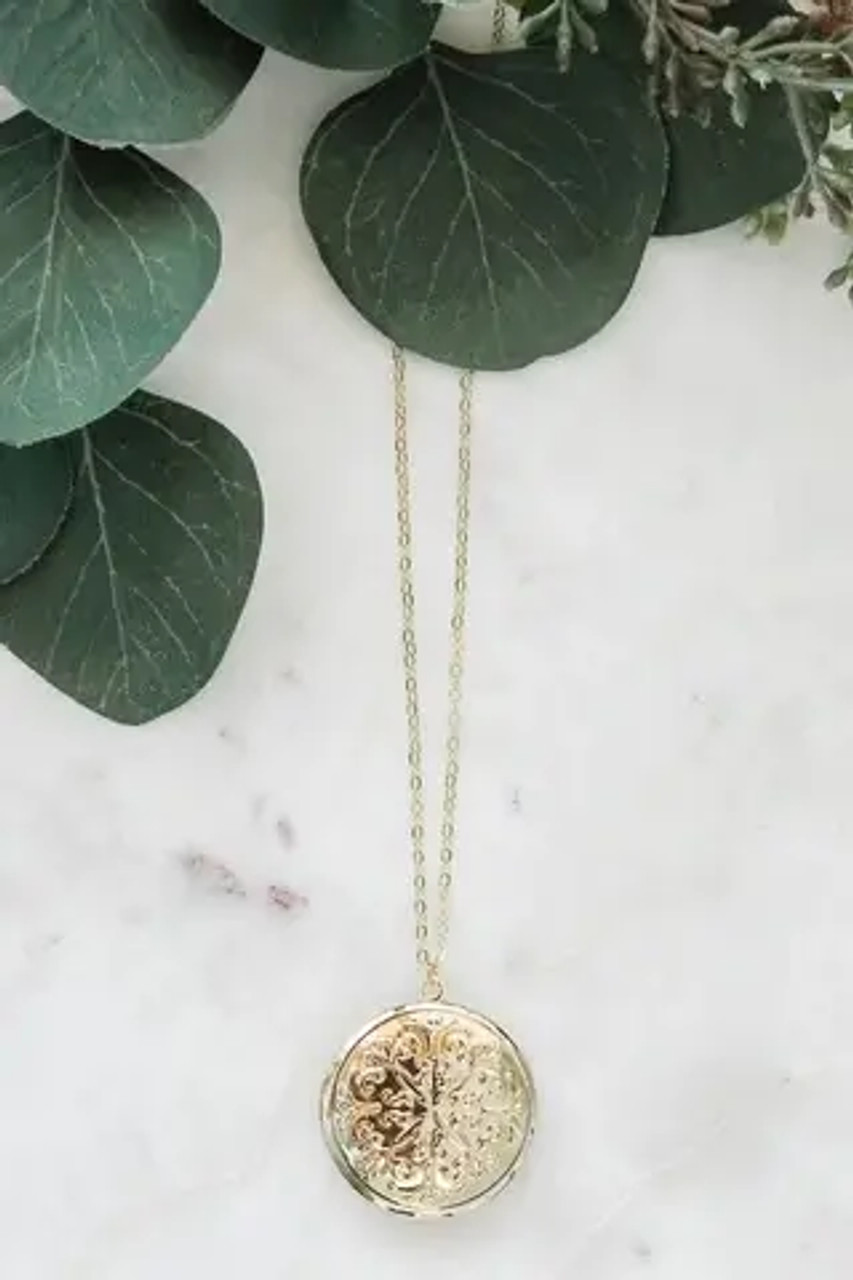 """Shiny gold colored locket with raised design on front is 1.5"""" and will hold two circle pictures up to almost an inch. Chain is adjustable from 18.5""""-20.5""""; lobsterclaw clasp. Nickel and lead free."""