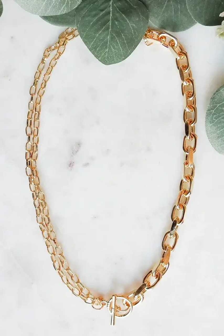 """This gold tone necklace has two smaller chains half way around and a chunkier single chain on the other half giving you several options for wearing it. Nickel and lead free, toggle clasp, 19.5""""."""