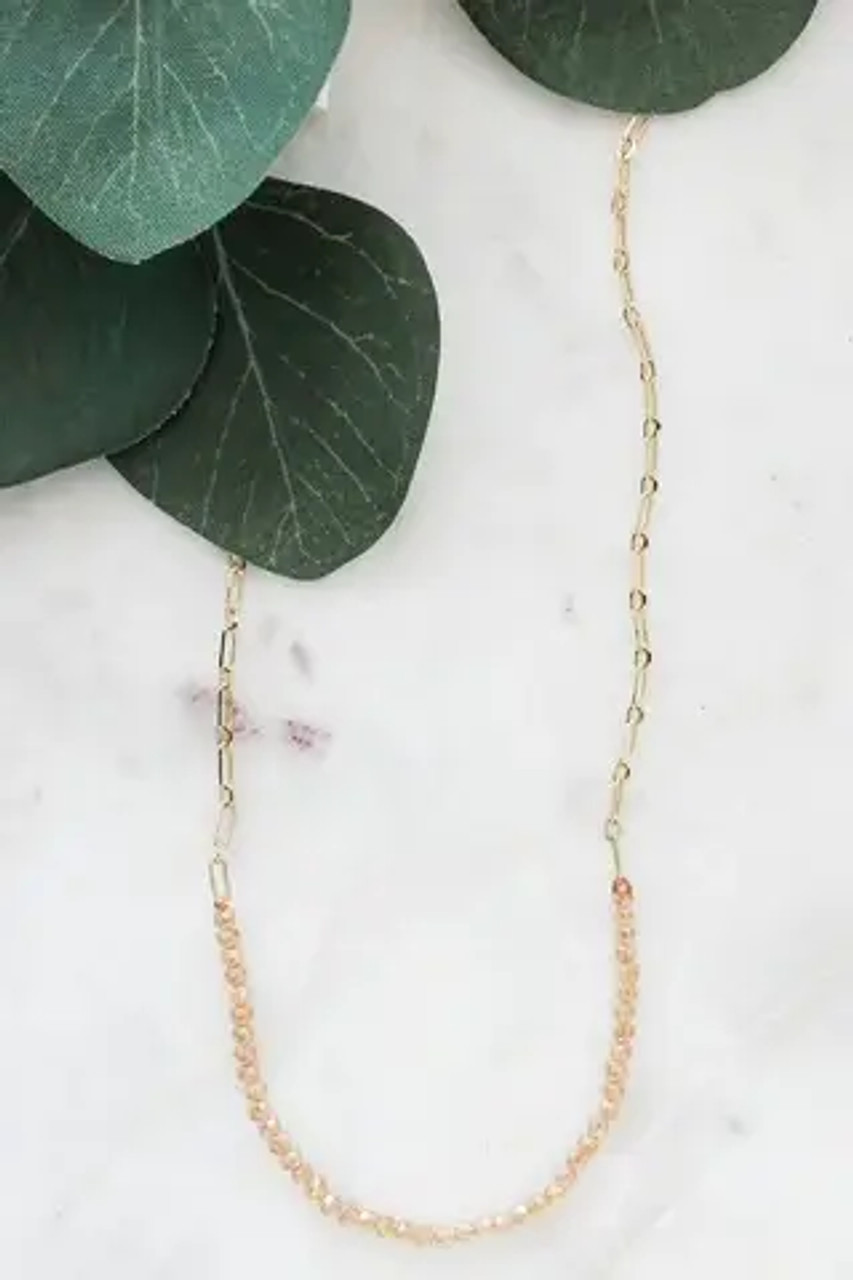 """Topaz colored beads cut to sparkle on a chain with alternating size links. Lobsterclaw clasp; adjustable from 15""""-17"""". Nickel and lead free."""