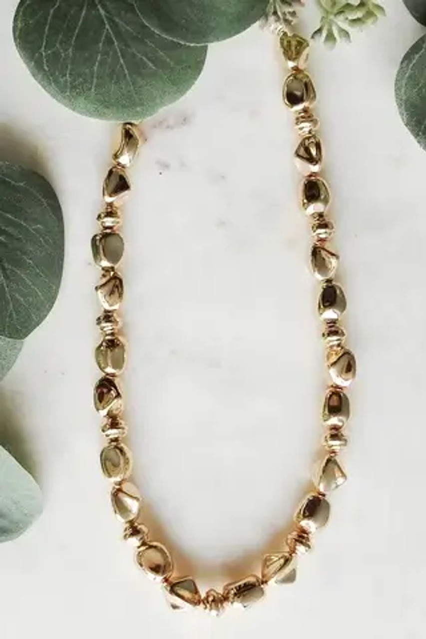 """Lightweight necklace of golden nugget beads. Adjustable from 15""""-18"""" with lobsterclaw clasp. Nickel and lead free."""