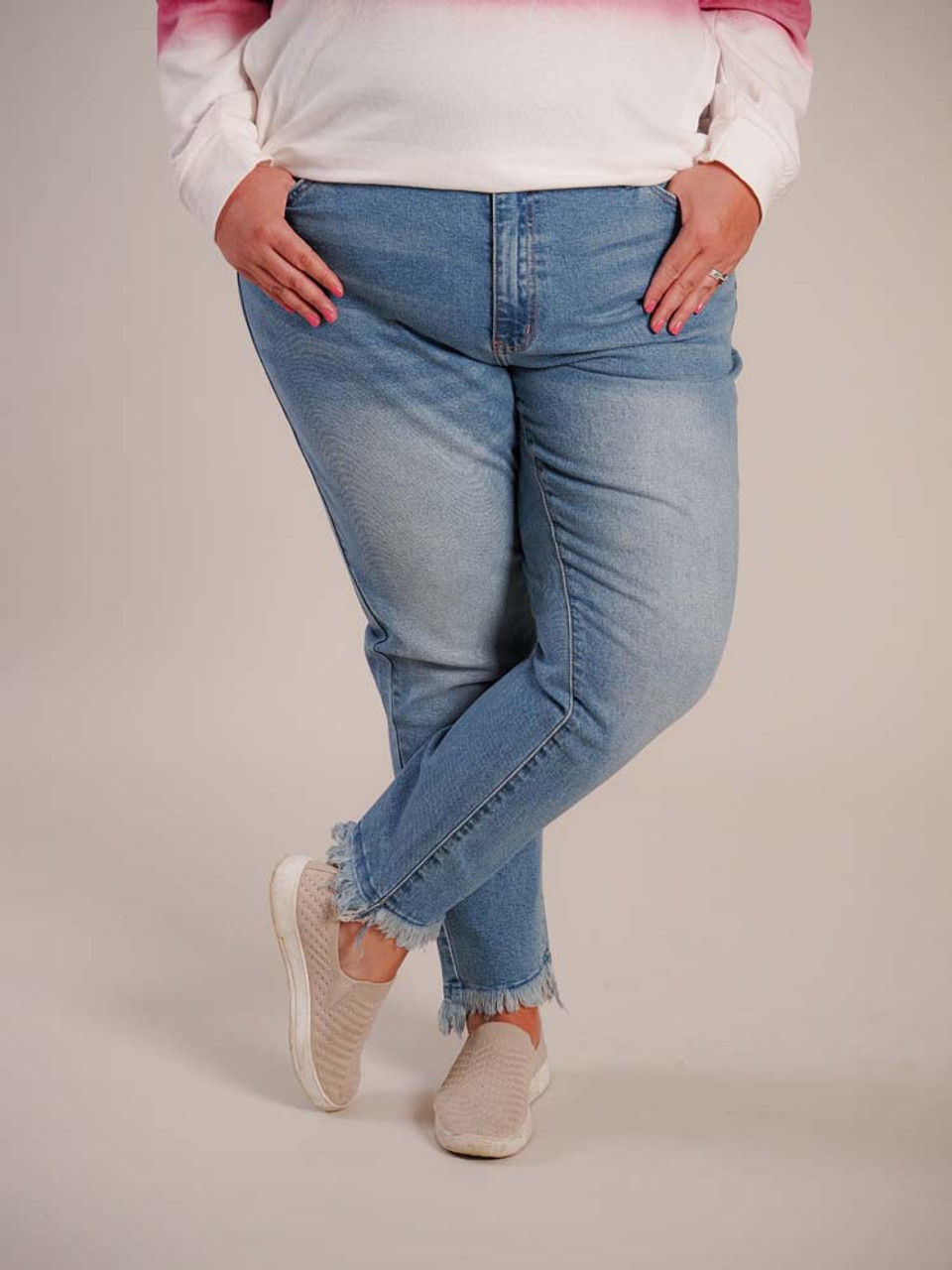 """Light blue denim jeans. Classic front and back pockets, relaxed fit, 27"""" inseam, frayed at ancles"""