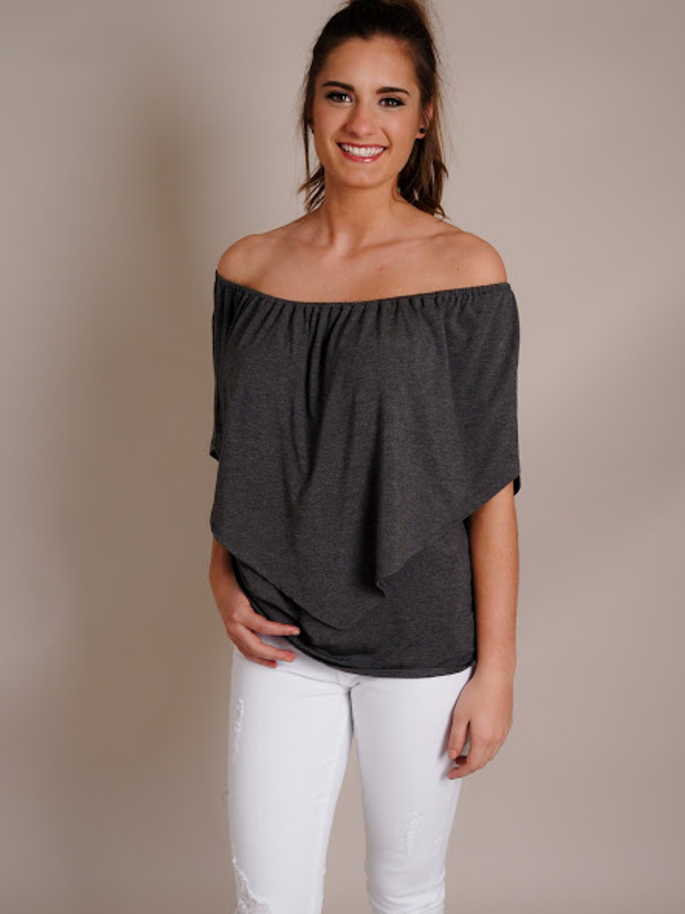 Woman in White Pants Models Off-the-Shoulder Gray Top