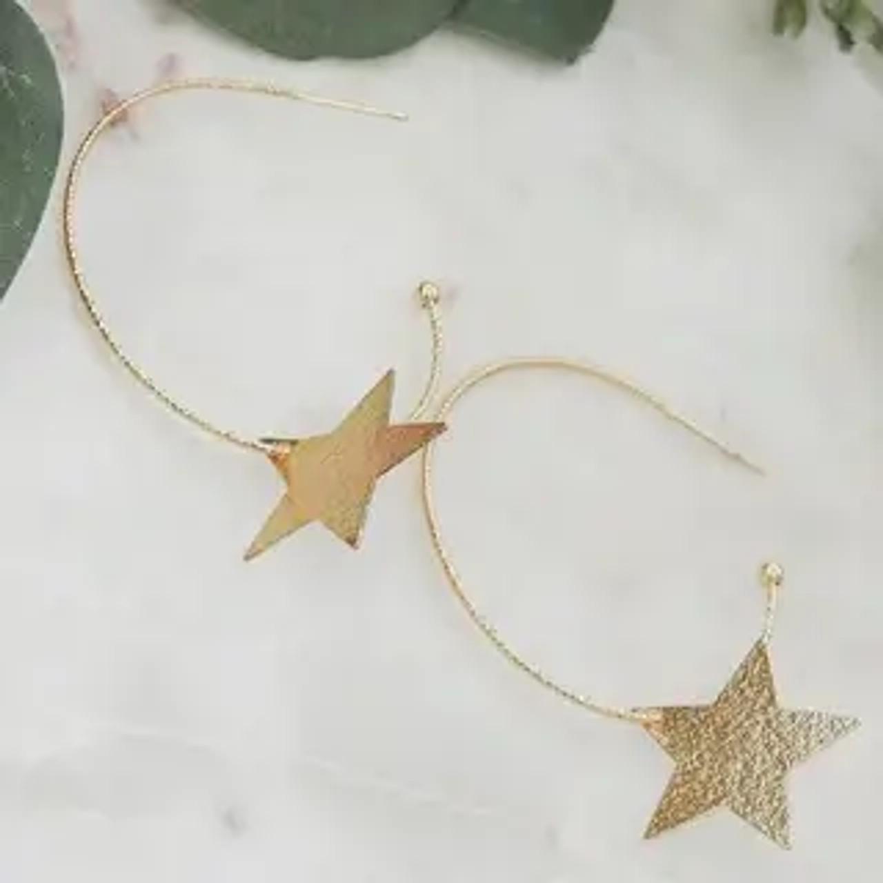 "Lightweight shimmery earrings. 1 3/4"" hoop with 7/8"" dangling star"