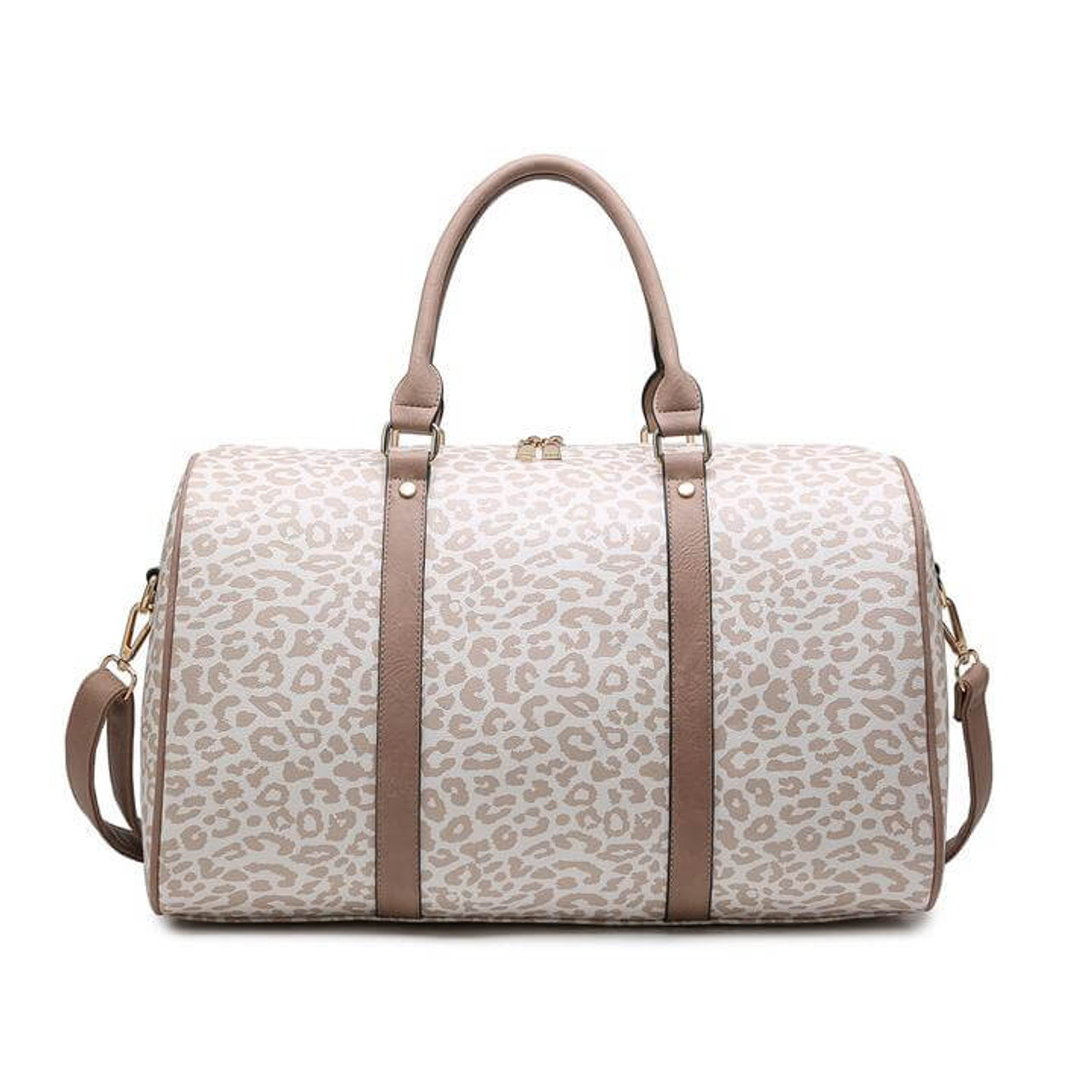 vegan leather duffel bag! Blush colored vegan leather and rose gold metal details. Includes one zipper and two slip pockets on the inside. The top zips closed and an adjustable/detachable shoulder strap is included