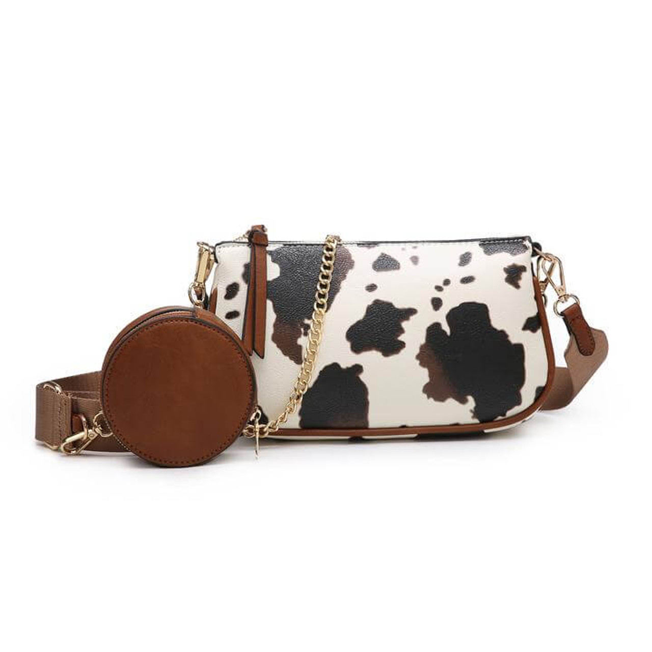 Marina is a high-end, versatile piece. Wear it with the chain or with the adjustable nylon strap--both are removable! The nylon strap includes a circular coin pouch that can also be removed. Features gold tone hardware and an inside zipper pocket