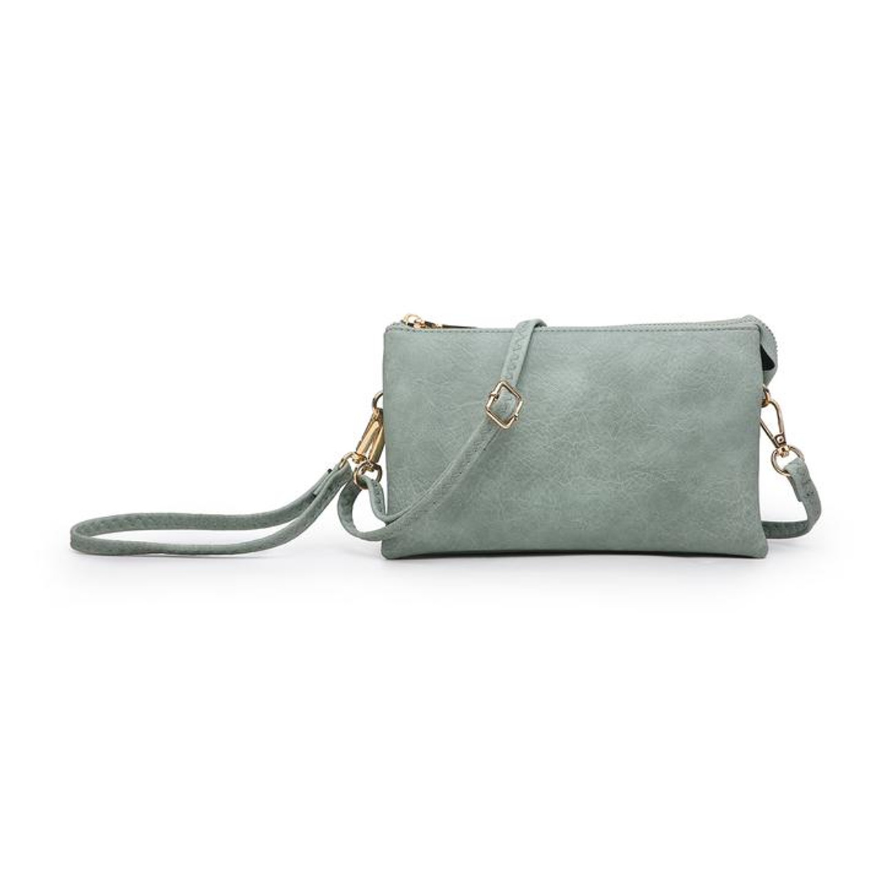 Wristlet and adjustable crossbody strap included. Three separate interior compartments with six credit card slots. Top zipper closure