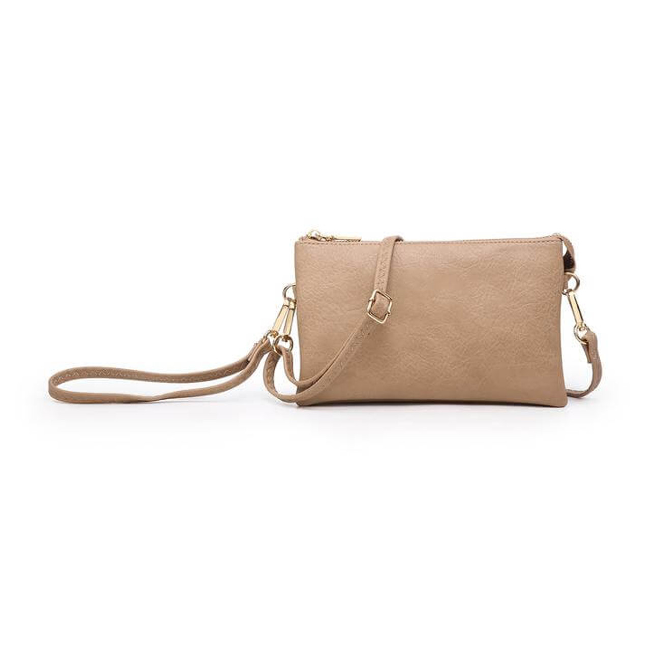 Wristlet and adjustable crossbody strap included. Three separate interior compartments with six credit card slots. Top zipper closure.