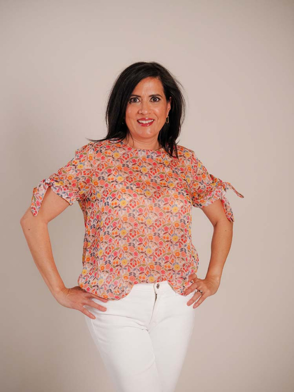 Sheer wildflower blouse. Round neck, short sleeves with loose knot detail