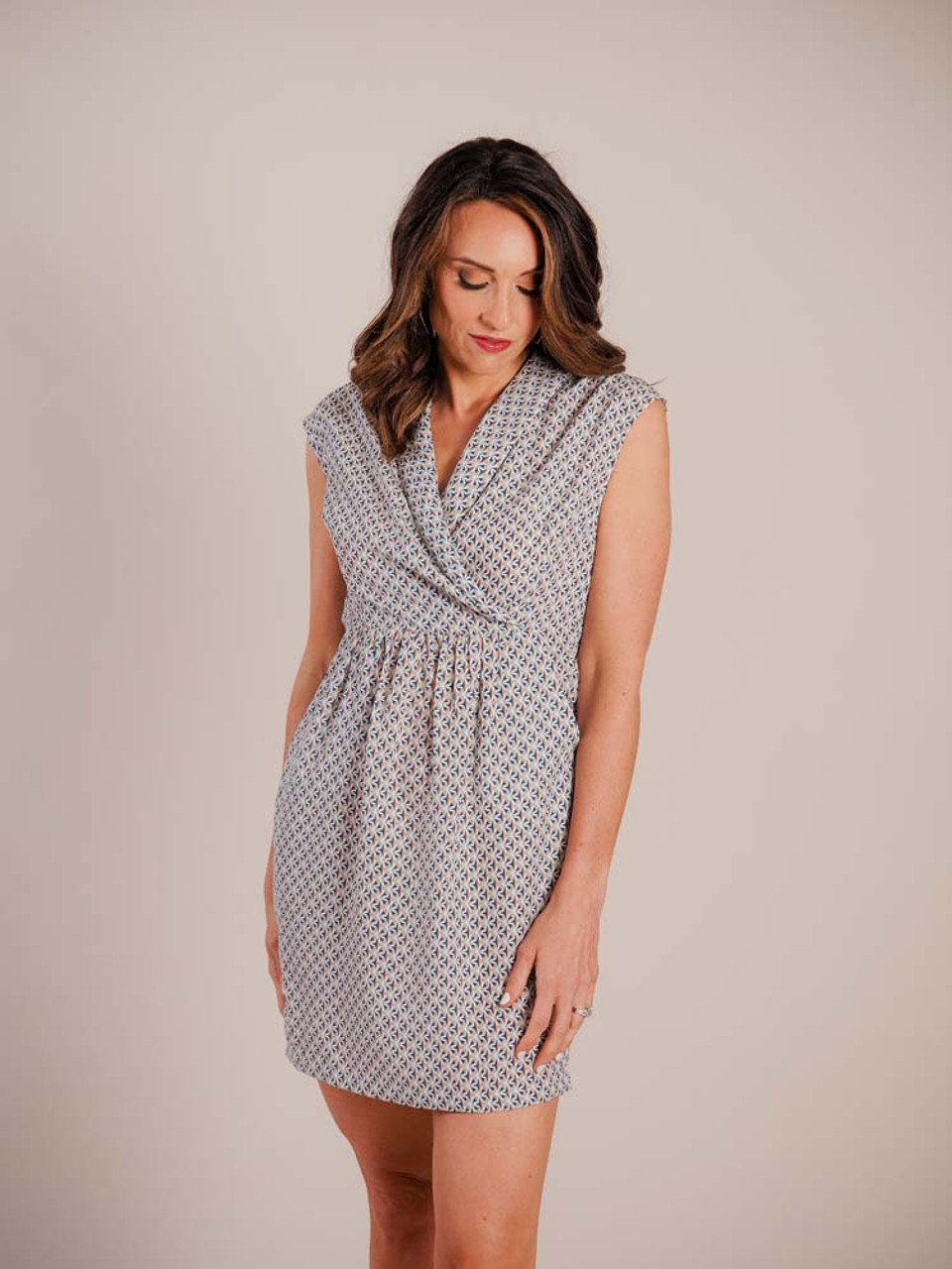 """This flattering dress has a v-neck wrap to elastic waist; pleated below waist in front; slanted pockets in front; 1"""" elastic gathered band at waist in back"""