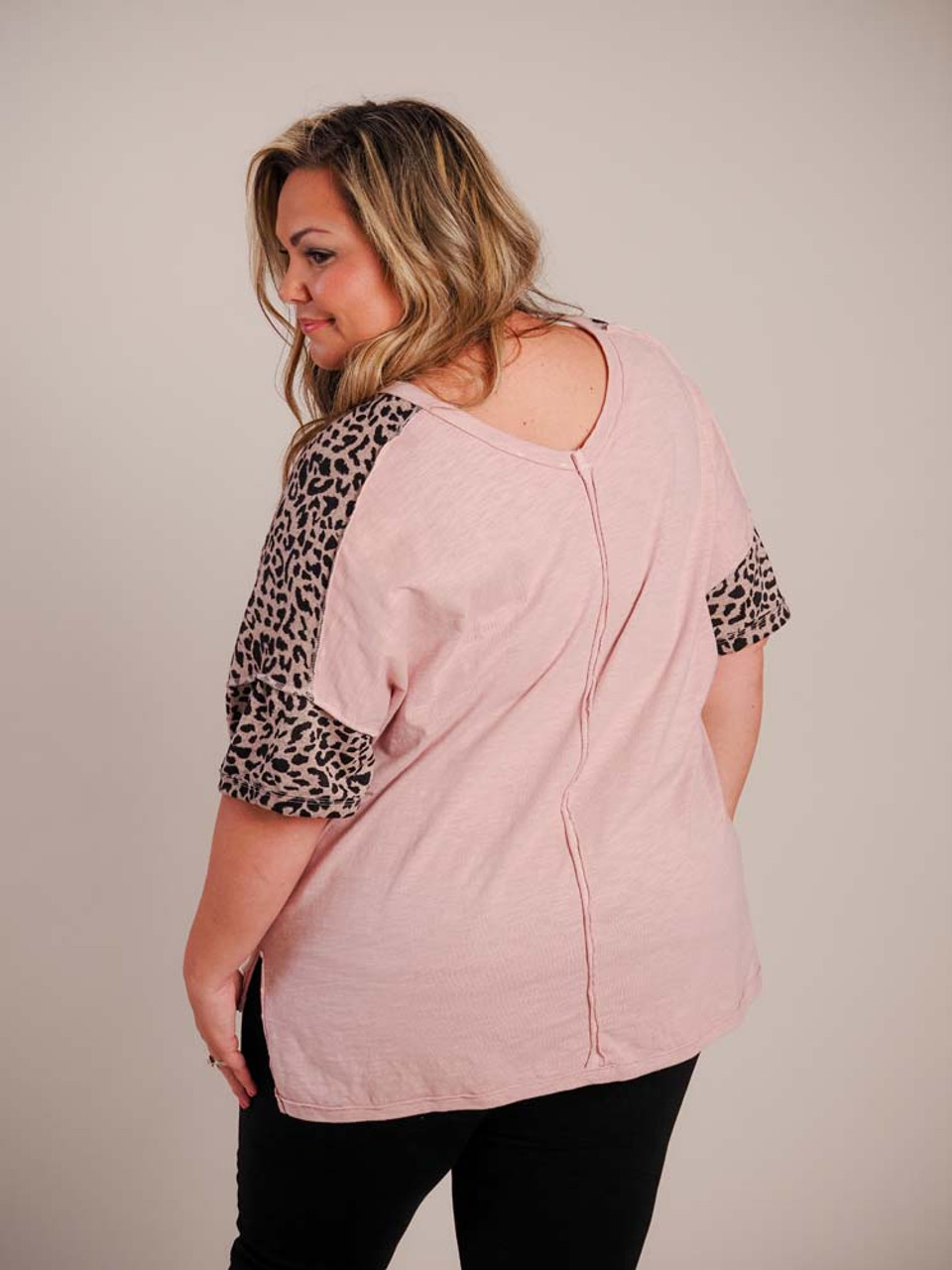 Wide v-neck; heatherd rose and black leopard print at shoulders, down sleeves, and at bottom of short sleeves; vertical raw seam detail down center of back