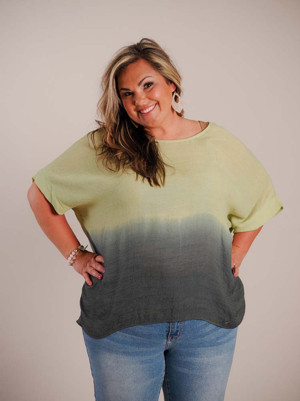 This sheer and breezy blouse has a round neck, short sleeves, and a vertical seam detail down the middle of the back