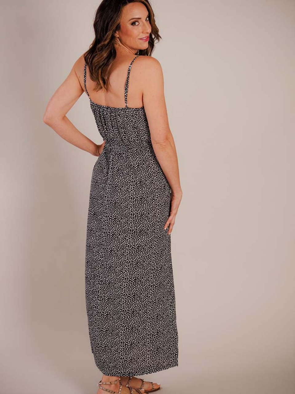 Peek-through lace along v-neck; adjustable straps; elastic across top of back; elastic at waist