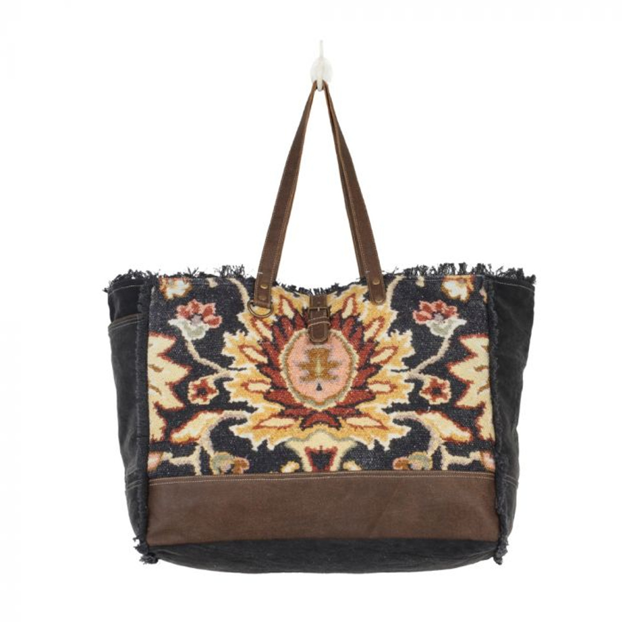 Beautifully printed bag with leather straps. Stuff it with all essentials and carry it with ease. Perfect for picnics, yoga sessions, and girls' day out! Leather at bottom of front; canvas back, sides, and bottom; freyed canvas trim; slip pocket on one side, zipper pocket on back; zipper close and strap with magnet button snap; double reinforced shoulder straps; fully lined inside with a zipper pocket and two slip pockets