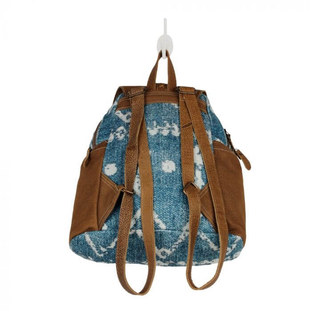 This hand-woven rug and leather backpack is a piece of perfection. With a beautiful blue and white print, this bag gives all the beachy summer feels. Zipper pockets on each side; zipper close at top with leather flap that snaps; handle and adjustable shoulder straps; fully lined interior with one large slip pocket