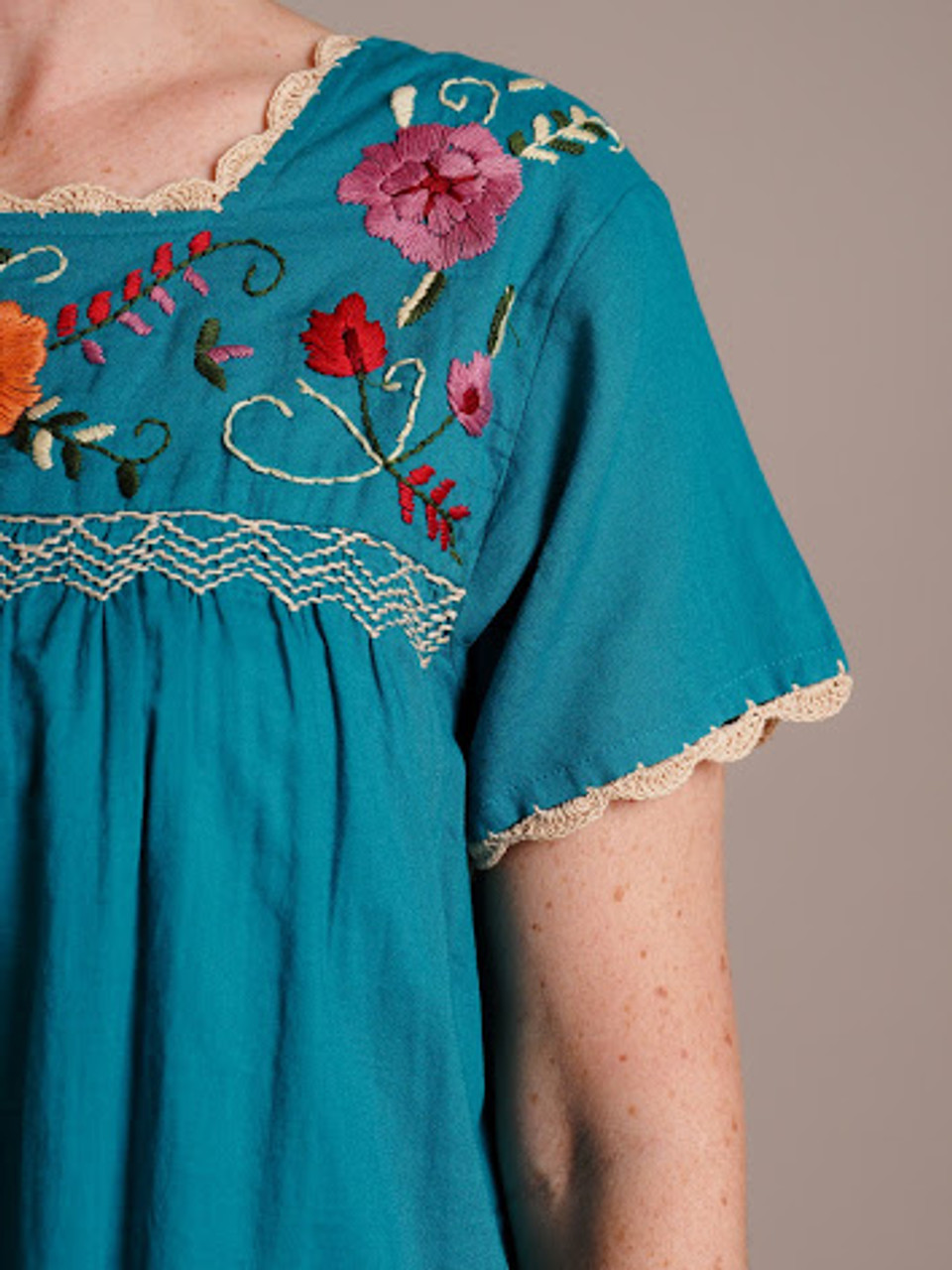 blue turquoise floral embroidered top
