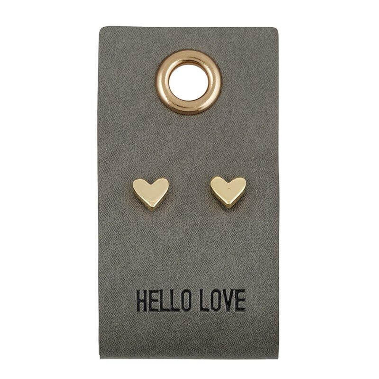 """""""HELLO LOVE"""" sentiment stamped on a 1"""" x 2"""" leather tag with .25"""" tiny heart stud earrings."""