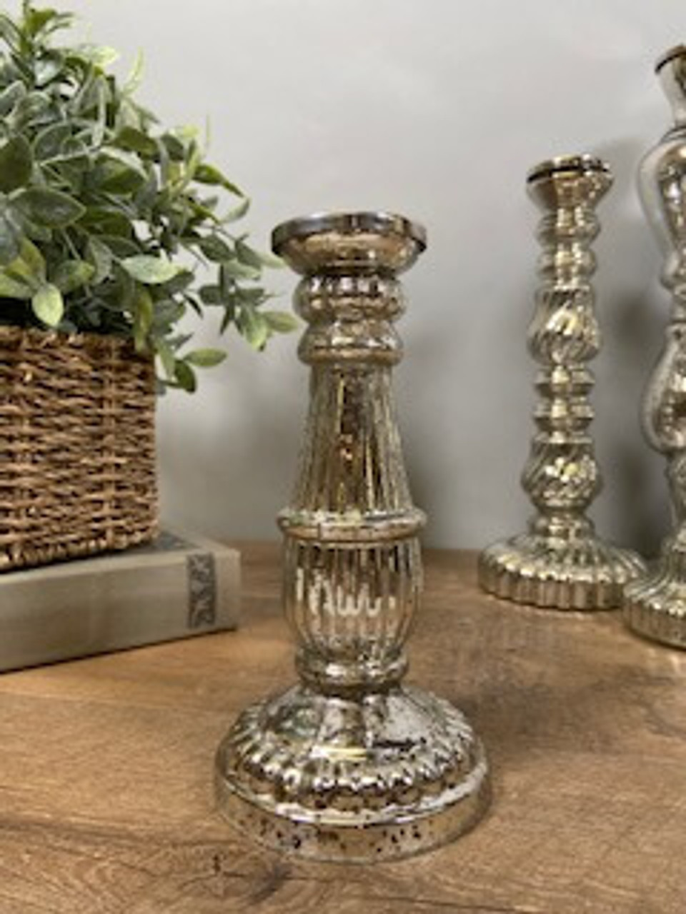 """Antiqued silver mirror glass taper candle holder. 7 3/4"""" tall; base is about 4"""" round."""