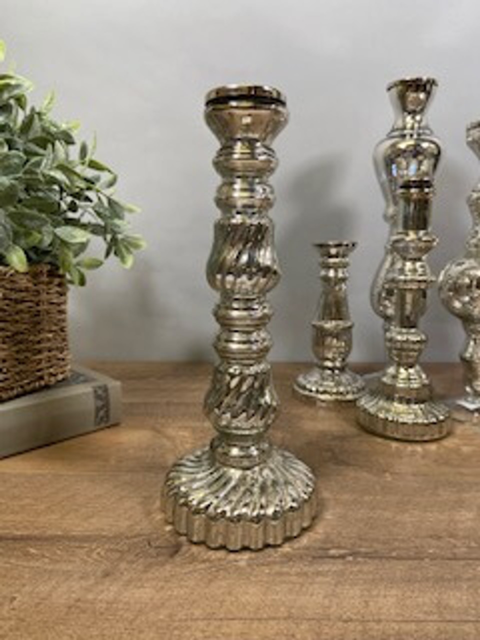 """Antiqued silver mirror glass taper candle holder. 11 3/4"""" tall; base is about 4 1/2"""" round."""