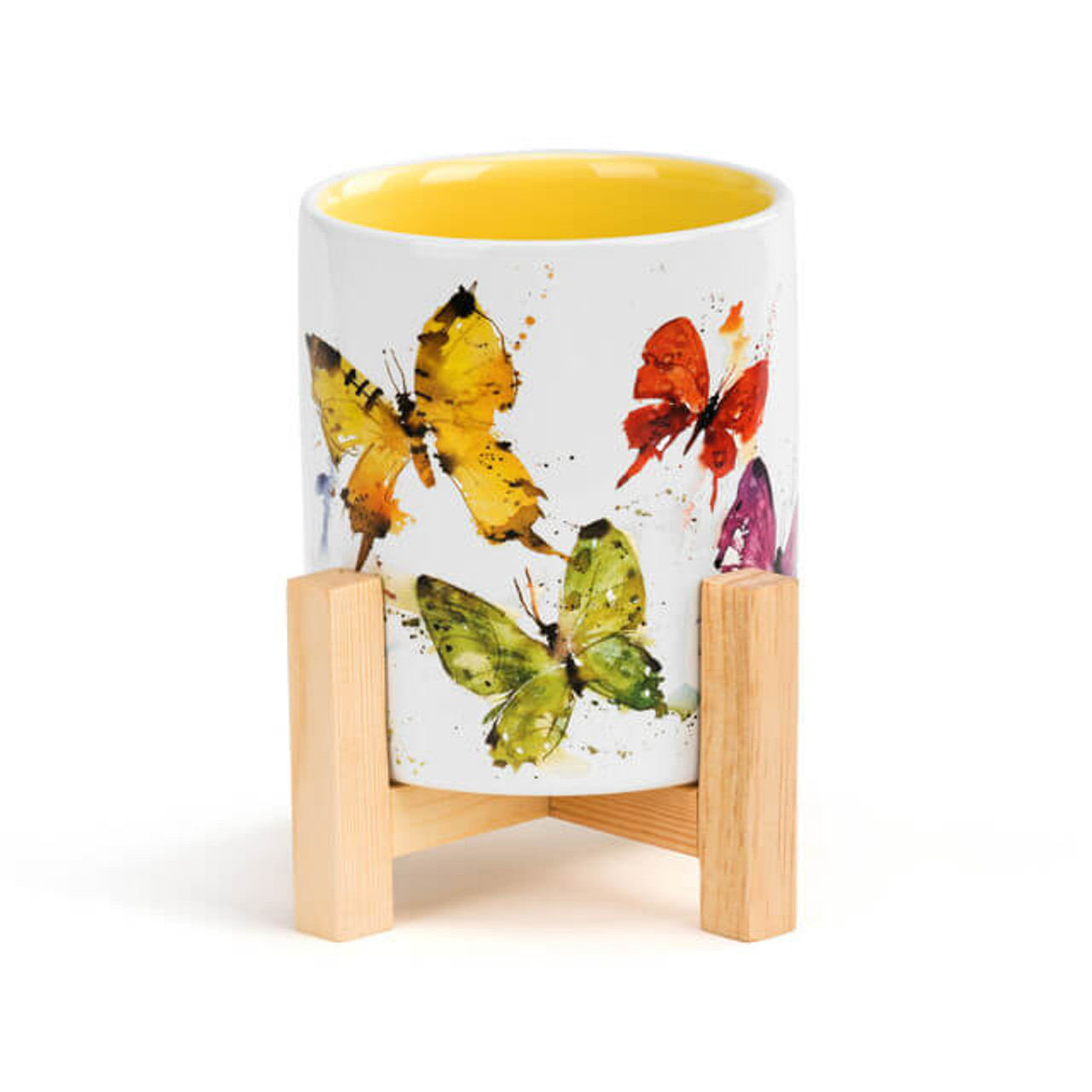 """Oregon artist Dean Crouser's vibrant watercolor works bring the beauty of nature onto this charming stonware mini planter. Features a burst of color with the painting of a flock of butterflies. Perched inside a bamboo base, this décor has the latest look for the inspired home. Makes a great housewarming gift as it brings the wonder of nature into any home and provides a useful function. 3.5"""" w x 6.5"""" t; holds 14 ounces and features a yellow interior."""