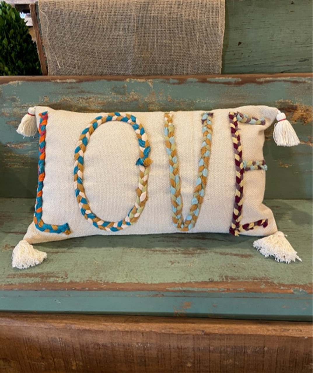 """Multi-color Chindi fabric """"LOVE"""" applique on 24""""L x 14""""H cotton lumbar pillow. Insert included. Each Chindi fabric applique is unique; this one features soft teal blues."""