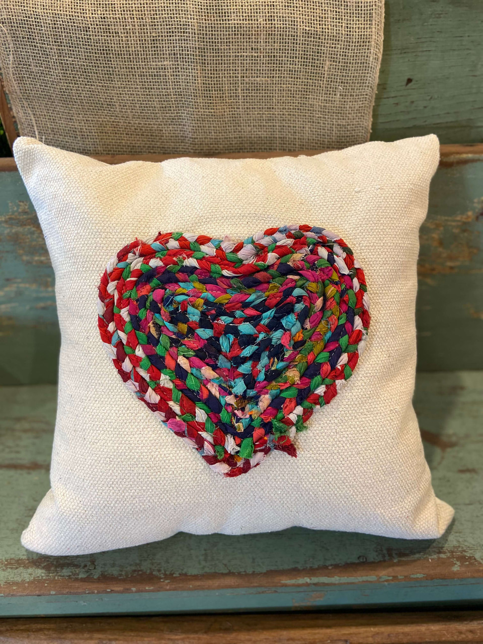 """Multi-color Chindi fabric heart applique on 20"""" square cotton pillow. Insert included. Each Chindi fabric applique is unique; this one features navy and teal blues."""