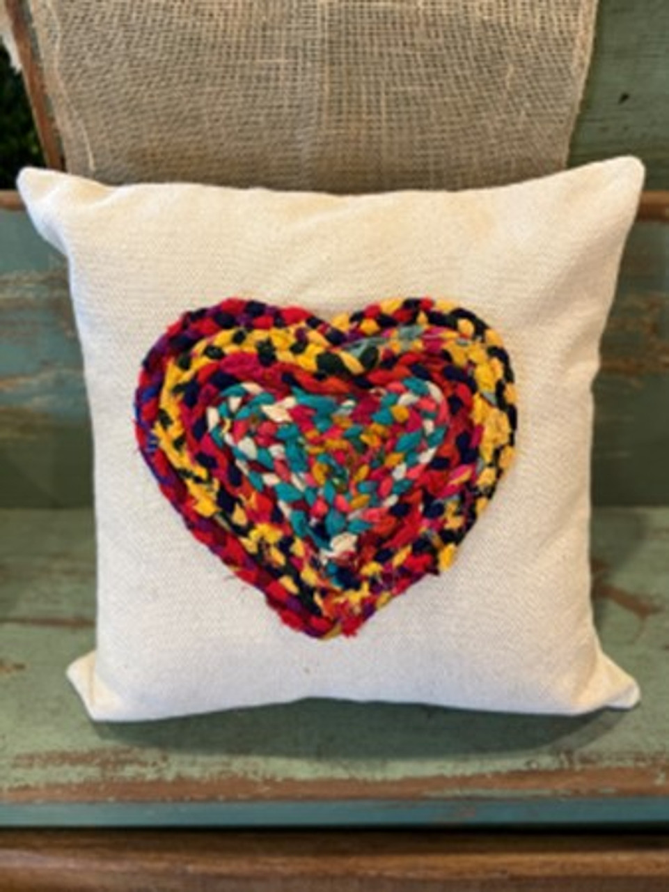 """Multi-color Chindi fabric heart applique on 20"""" square cotton pillow. Insert included. Each Chindi fabric applique is unique; this one features gold, navy, and teal blue fabrics."""