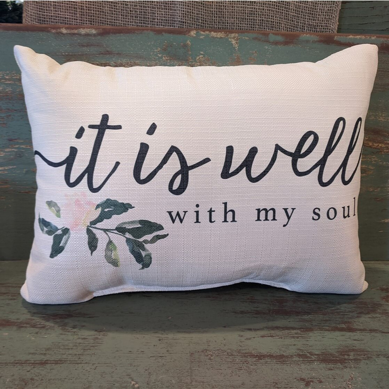 """The perfect way to cozy up any space! """"it is well with my soul"""" sentiment and floral design are dyed directly into the fabric, so it won't peel or crack. Made from a soft yet durable polyester fabric, your pillow will arrive stuffed with poly-fill and sewn shut. Approx. 20"""" W x 14"""" H; machine washable in cold water, delicate cycle- fluff, air dry flat."""