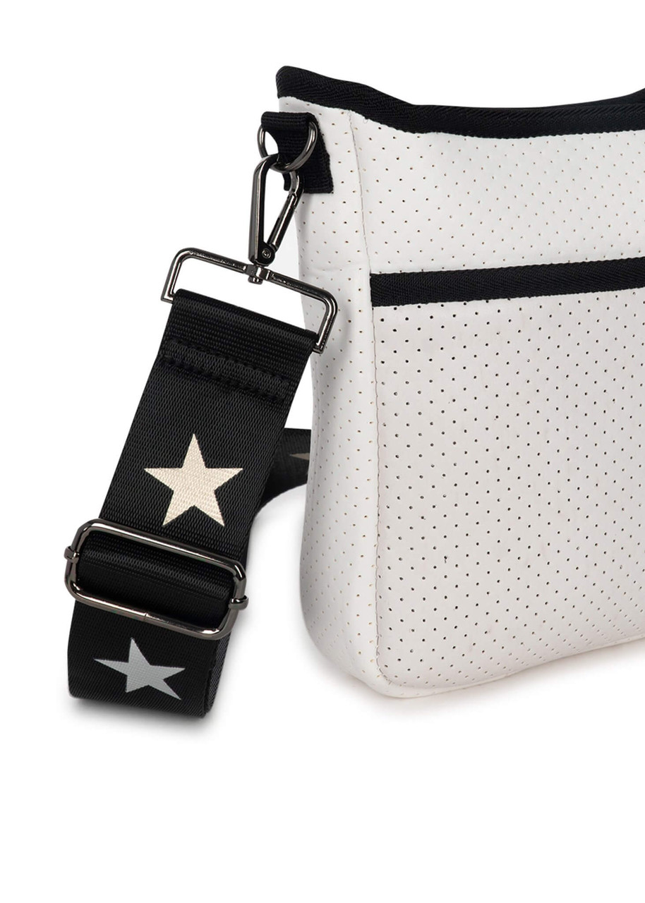 """White coated perforated neoprene crossbody.  2 straps included: black / white stripe with gunmetal chain, and black with metallic star design  Small crossbody with top zipper closure and hidden front zipper pocket.  8.5"""" W x 2"""" D x 9.5"""" H"""