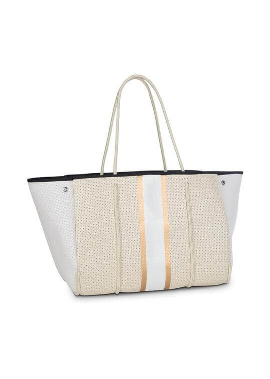 """Solid beigecoated perforated neoprenewith white side panels, beige straps, gold/white stripe, and black lining  This neoprene tote is the perfect blend of style and functionality.   Ultra light weight  Side panels expand for a phantom shape or snap in for a streamline look  Removable hard bottom liner  Removable wristlet pouch  Washable with mild soap. Hang dry. Hand wash recommended.  Dimensions:18"""" W with side panels expanded (14.4"""" W with side panels snapped closed) x 12"""" T x 10"""" D.a  Pouch measures 8.5 inches wide by 6 inches tall"""