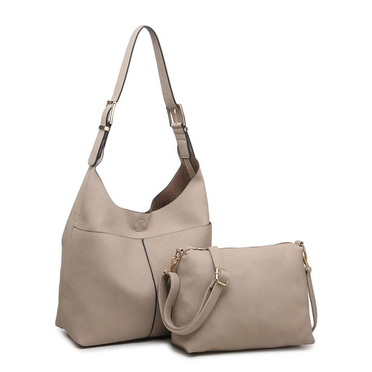 This slouchy hobo includes an inside bag with an adjustable crossbody strap. The hobo bag itself has an adjustable buckle strap, 2 front slip pockets, and a magnet snap close at top. Inside of crossbody bag is fully lined and features two slip pockets and 2 zipper pockets; zipper close at top. Crossbody bag snaps in to inside of hobo to keep your items secure and organized.