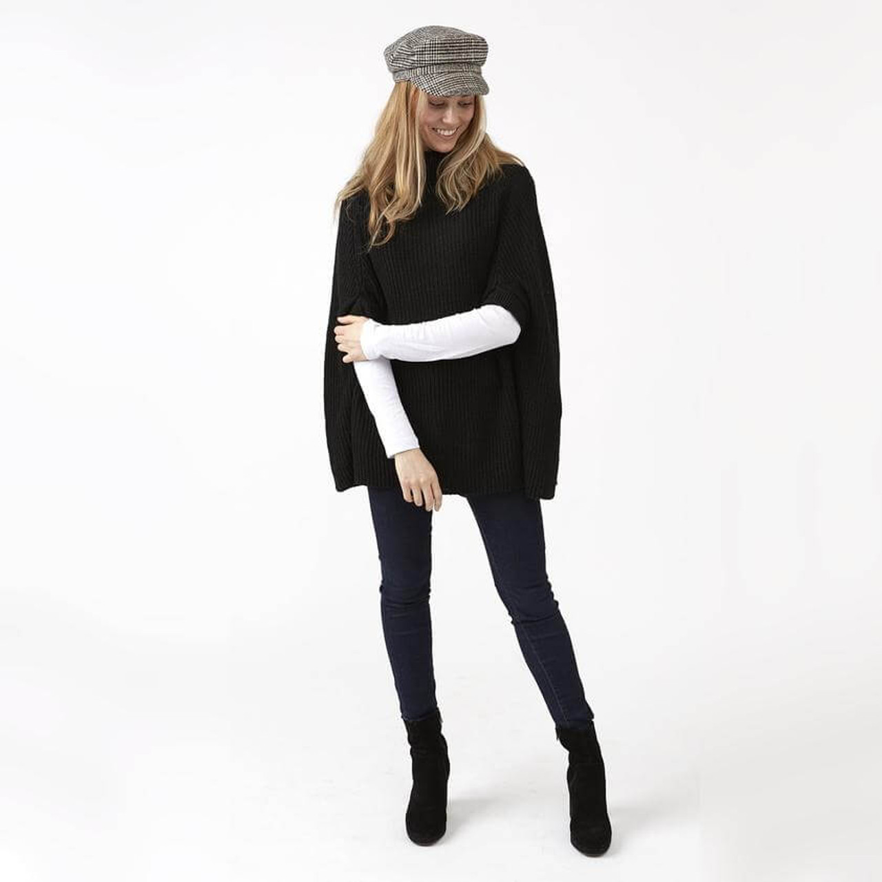 This modern knit black Victoria sweater poncho is perfect for the office, a day of shopping, or even date night. The neutral color and effortless style will have you looking chic and feeling warm wherever you go. One size fits most.