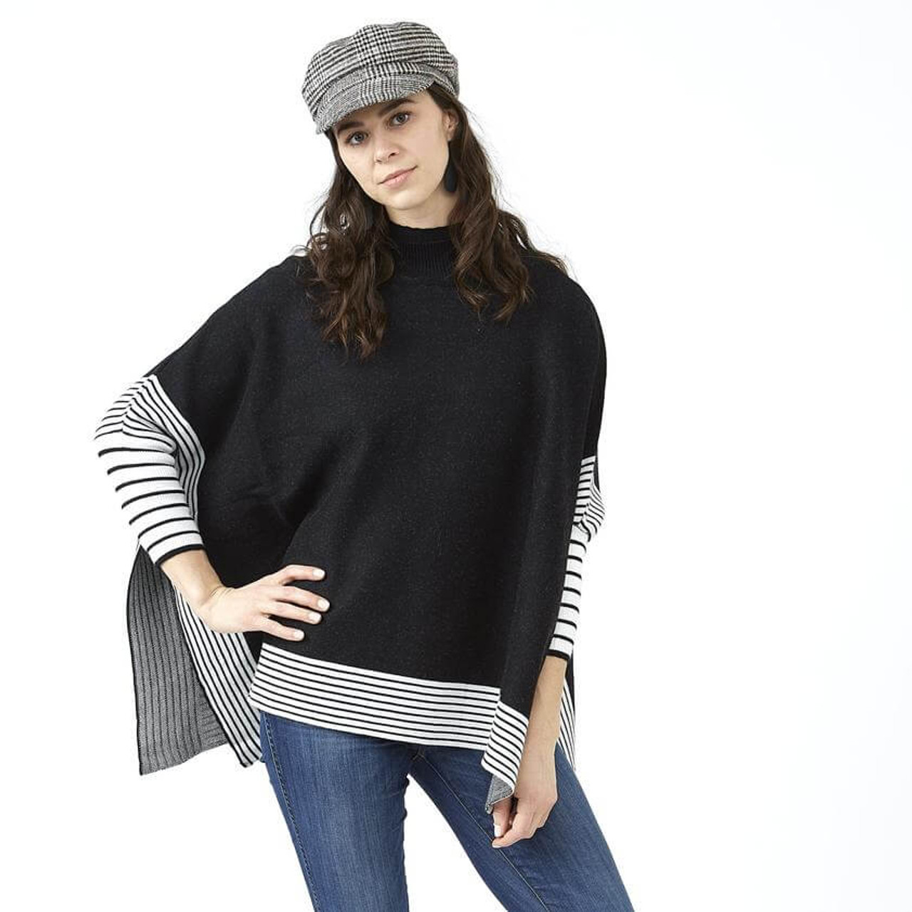 """This modern style Eddie poncho in black will pull your look together while keeping you nice and warm. Approx. 35 x 28""""; one size fits most."""