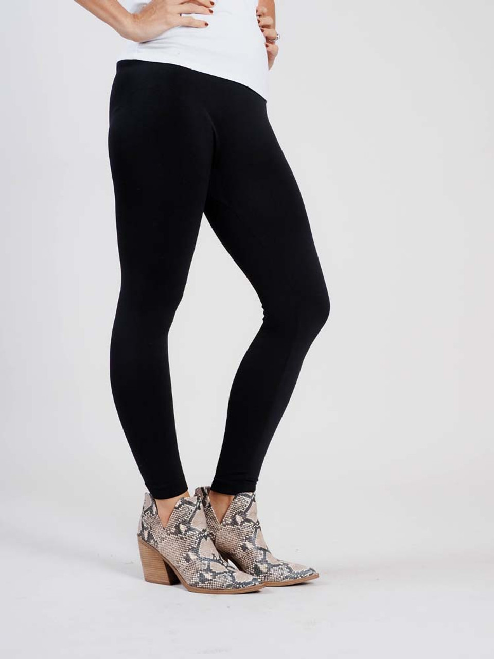 """Black Comfortable and versitable fleece-lined leggings, breathable fabric, smooth mid-rise fit, seamless, flattering 4"""" waistband, full length cut with banded ankle"""
