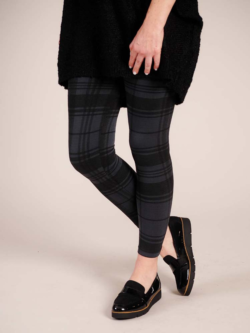 """Gray/Black Plaid Comfortable and versitable fleece-lined leggings, breathable fabric, smooth mid-rise fit, seamless, flattering 4"""" waistband, full length cut with banded ankle"""