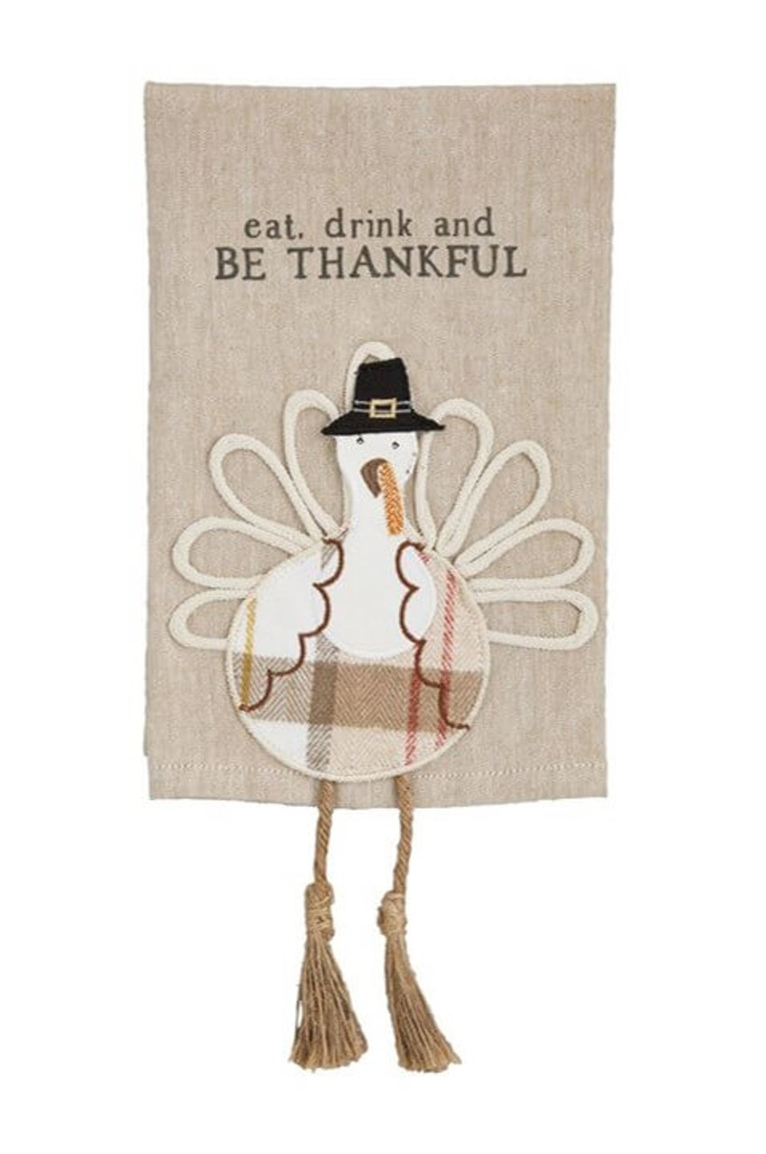 Cotton towel features turkey applique with twine dangle legs and tassle feet.