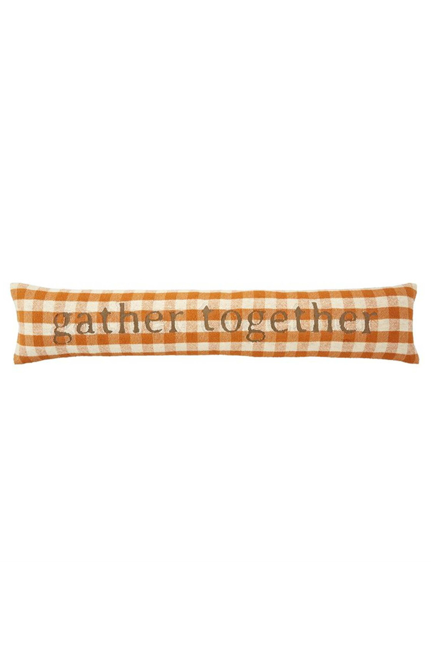 """Cotton buffalo check skinny pillow with brown canvas behind """"gather together"""" cut-out detail."""