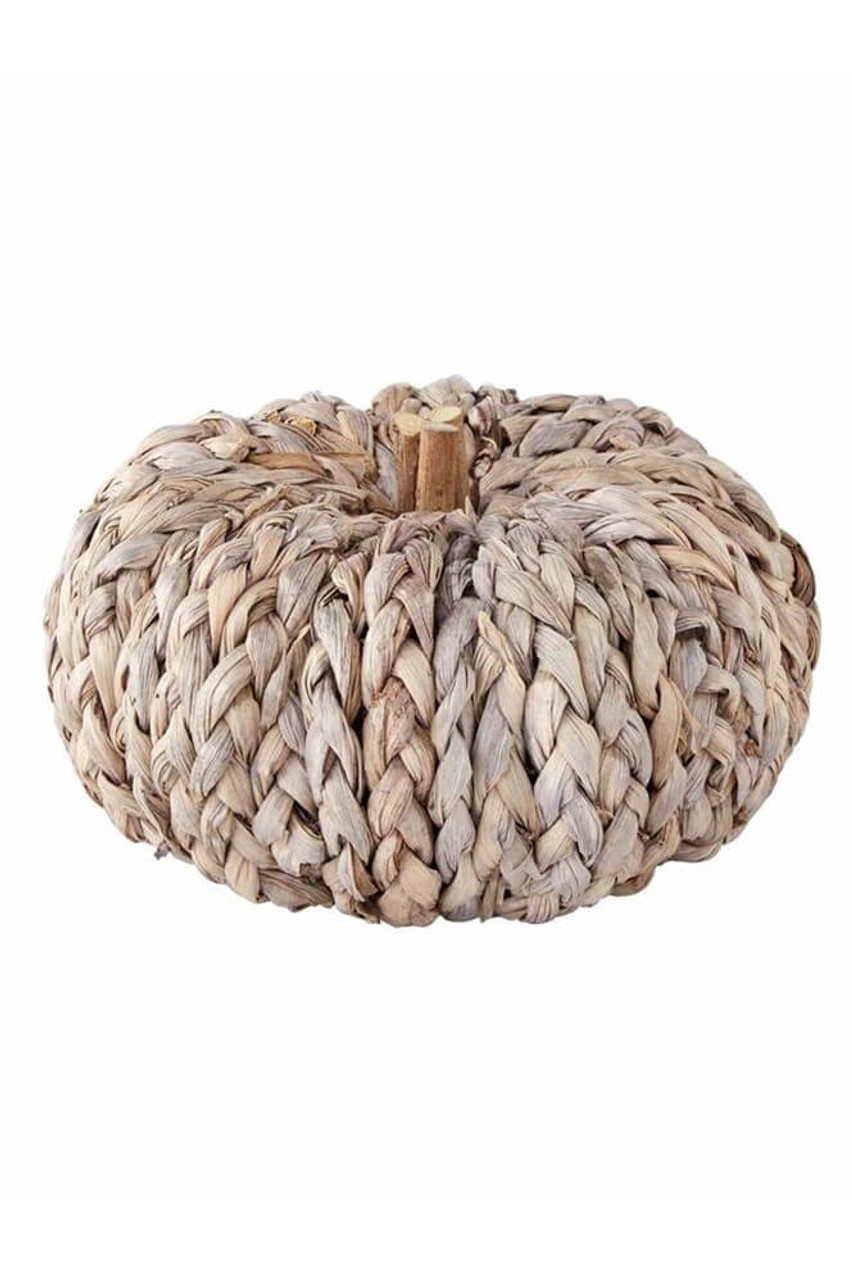 """Small 3"""" x 6"""" dia pumpkin wrapped in braids of natural gray colored corn husks."""