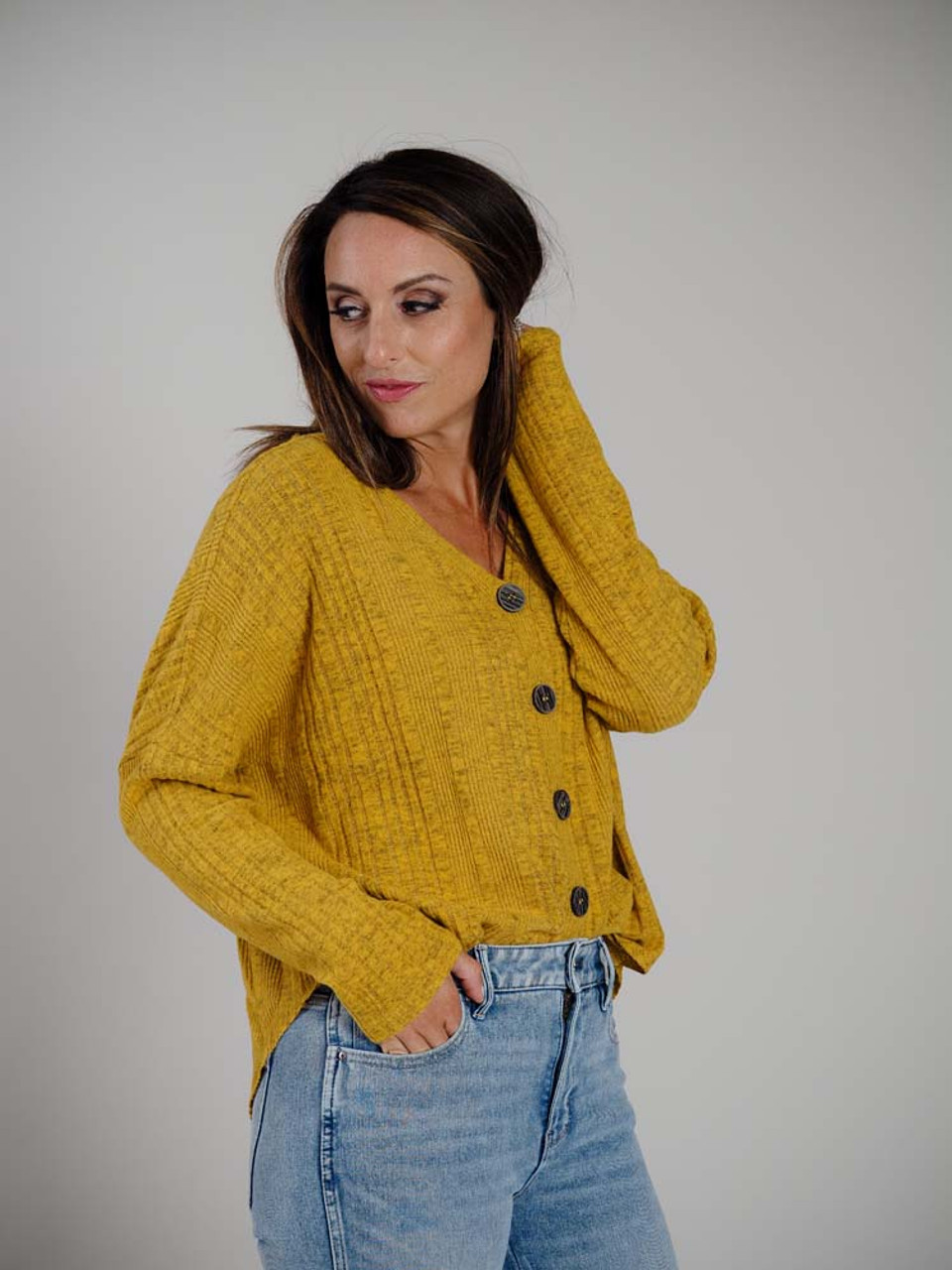 """Heathered golden yellow with varied ribbed detail. Oversized fit, unfinished around the v-neck, 5 1"""" buttons down the front, long sleeves"""