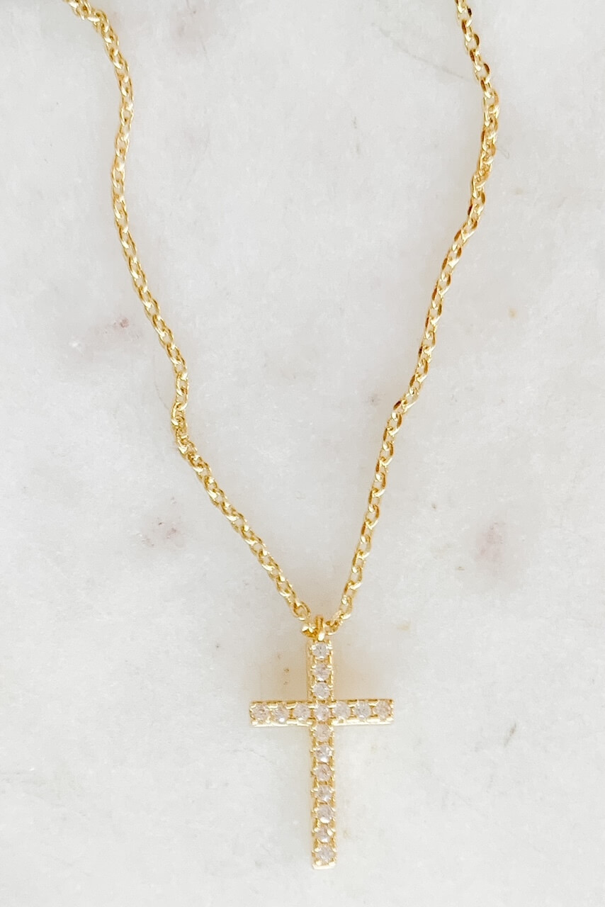 """Gold dipped dainty necklace attached to 5/8"""" sparkly cross charm. Adjustable from 15"""" - 17"""" with lobsterclaw clasp. Nickel and lead free."""
