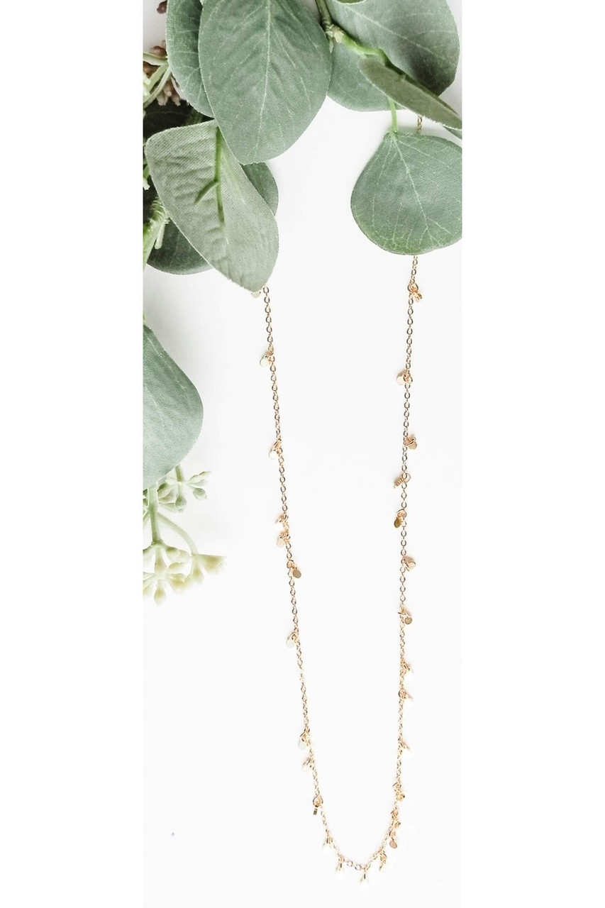 """Long dainty necklace with 1/8"""" circle charms all along to give it lots of sparkle and shine! 28 1/5"""" with lobsterclaw clasp. Nickel and lead free."""