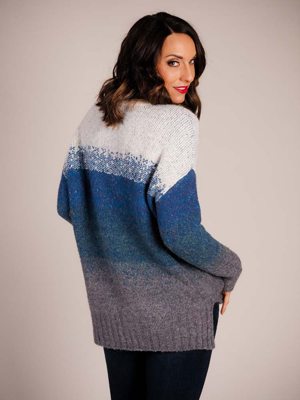 Beautiful warm sweater with bright cream around the neck and vibrant cool colors in an ombre pattern down to grey at wrists and waist, slightly longer in back than front