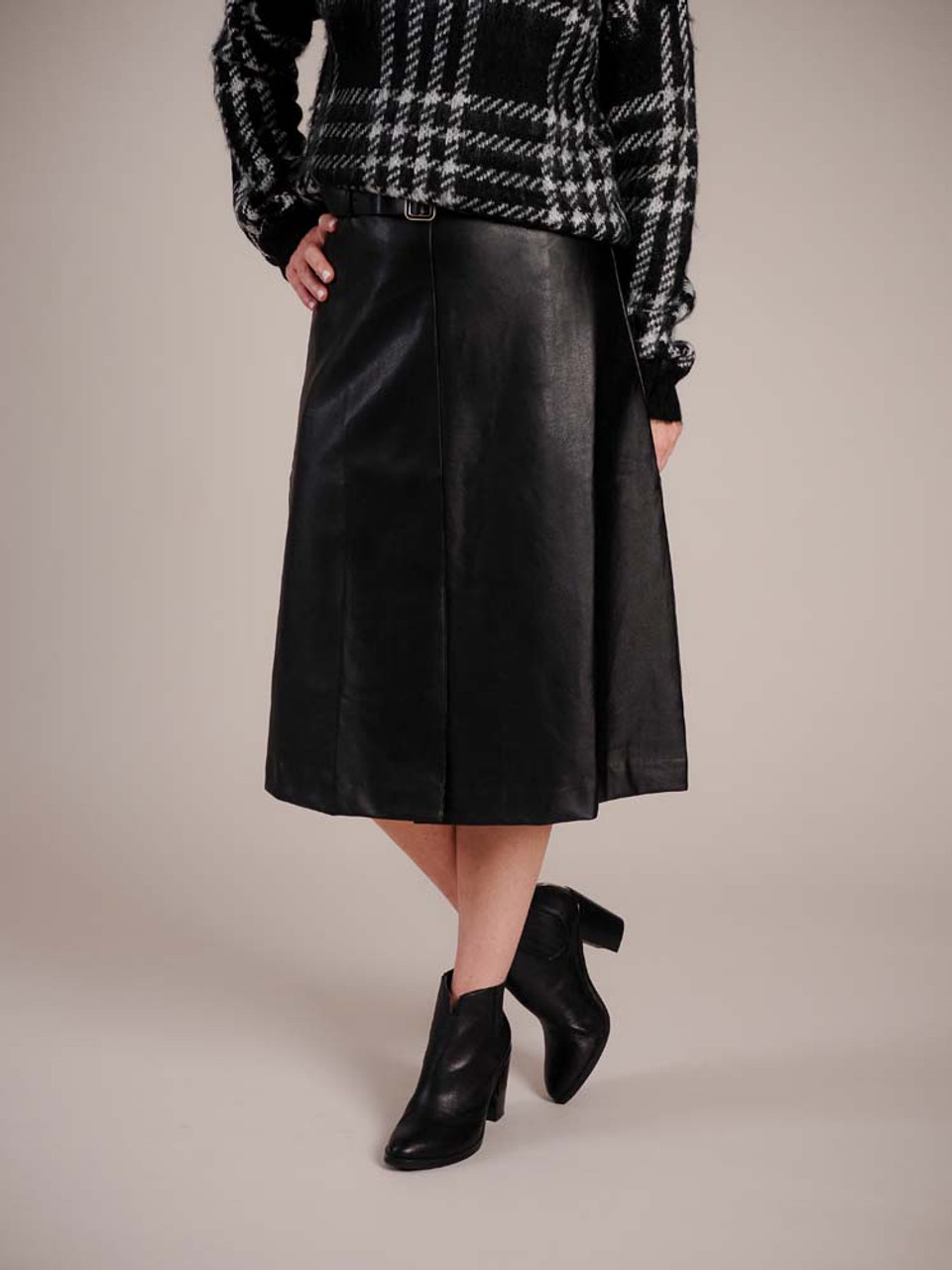 """Buttery black faux leather high-waisted pencil skirt. Matching belt at waist with black and soft gold buckle, center seam at front with 9"""" split, 2 pleats and a center seam at back, 28"""" long, lined half way down from waist"""