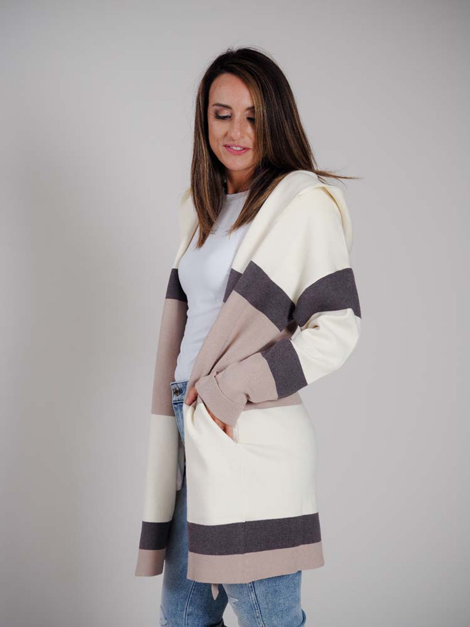 """Wonderfully soft and warm without being too heavy, this cream, gray, taupe hooded cardigan has long sleeves that are cuffed at the wrist, slit pockets in the side hems, and is 35"""" from shoulder to bottom"""
